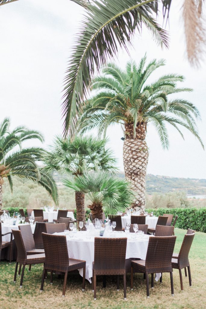 Tables under the palm trees at a wedding at the Convivium Hotel in Vasto