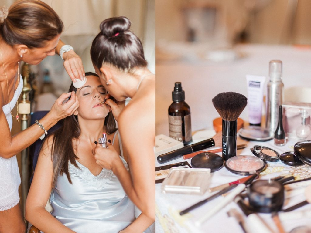 Italian bride having her make-up applied by two make-up artists on the morning of her wedding in Abruzzo