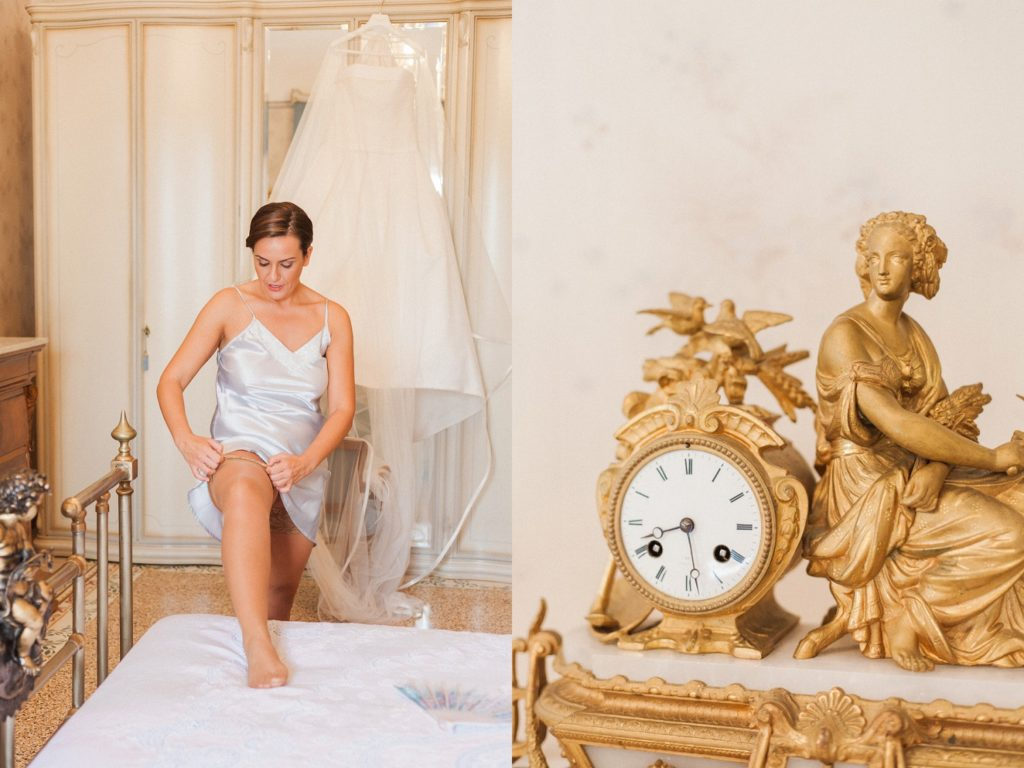 Gold antique clock shows the time as the bride puts on her garter on her wedding morning