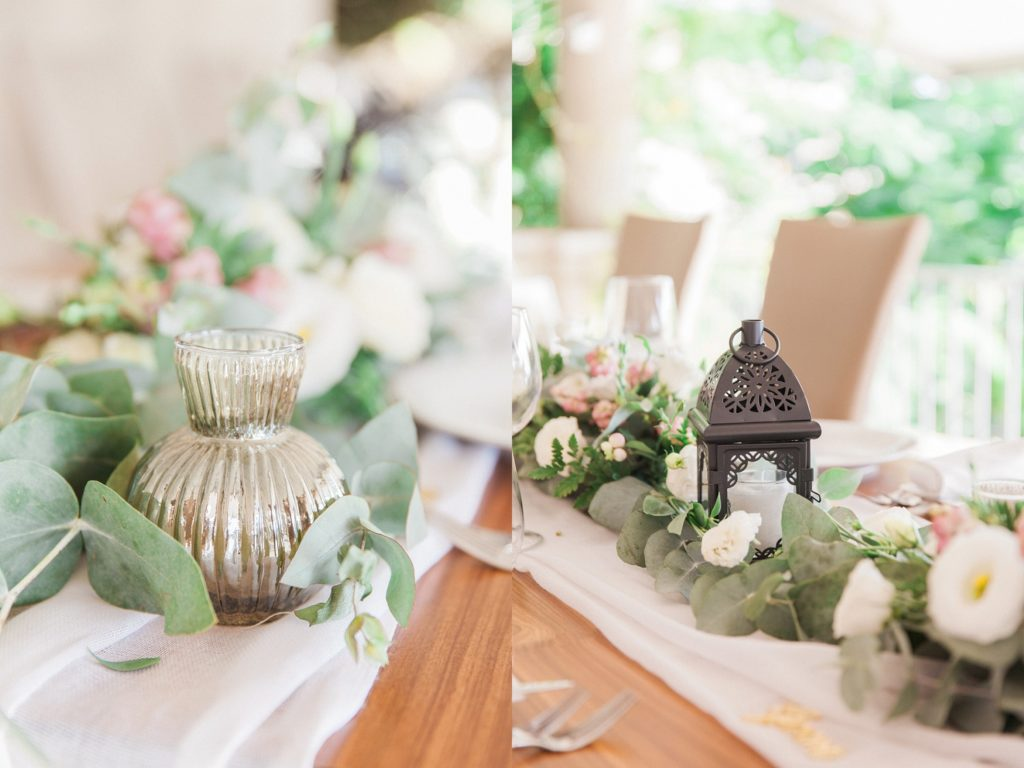 Wedding centrepiece detail images featuring a small mirrored vase, a black lantern and pink and white flowers