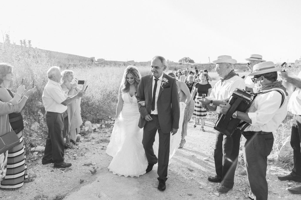 Bride and her family arrive at the church in Santa Maura Castle in Lefkada
