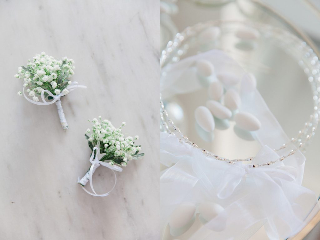 Grooms buttonhole and silver Greek wedding crowns