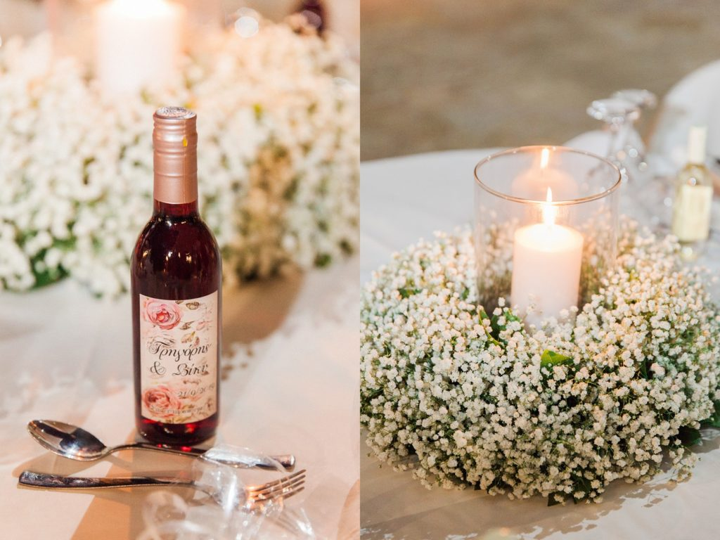 Personalised red wine favour and gypsophila centrepiece at Ionian Blue Resort Hotel and Spa
