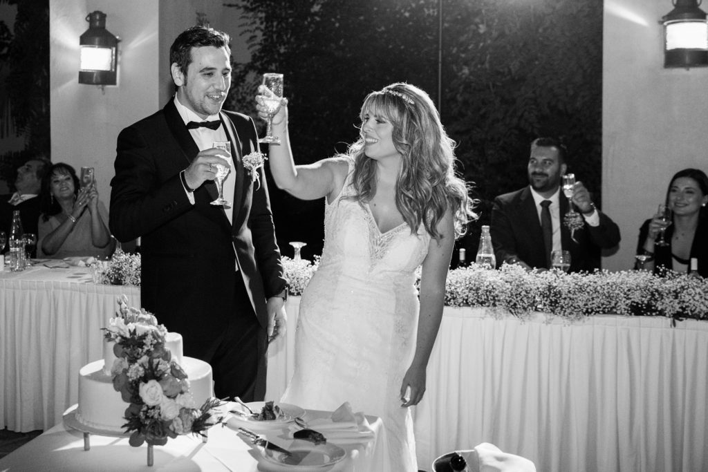 Couple raise a toast to their guests at Ionian Blue Resort Hotel and Spa