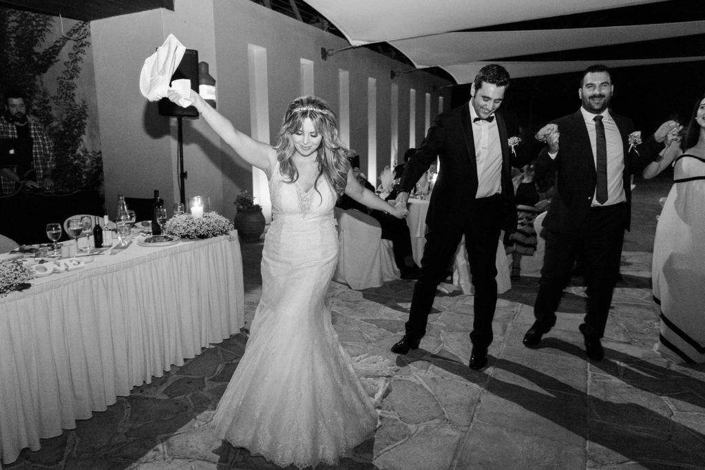 Bride leads the traditional dancing at her Ionian Blue Hotel wedding on Lefkada in Greece