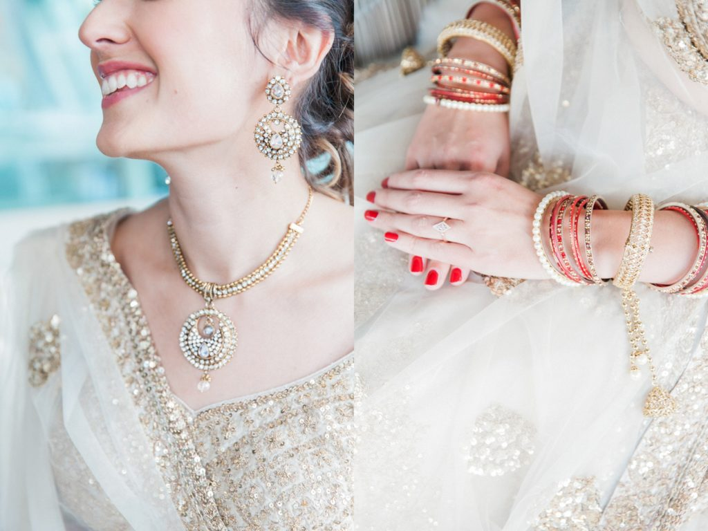 Bridal details showing her traditional Indian gold jewellery and bangles