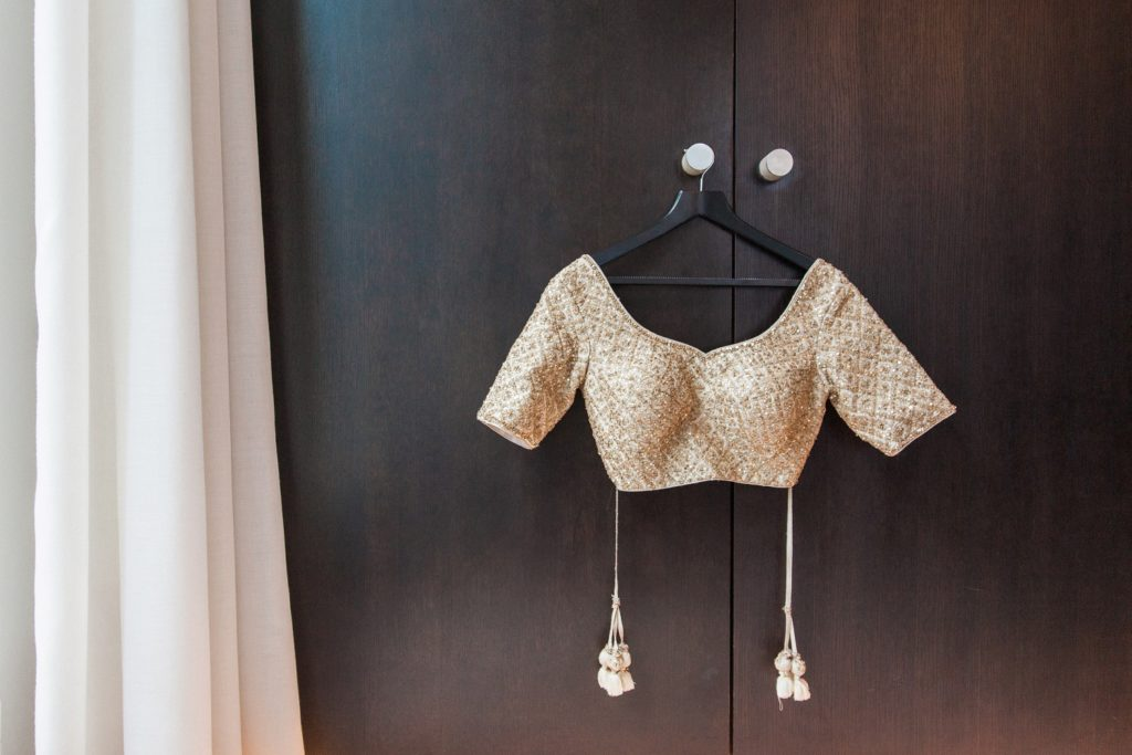 Indian brides gold lehenga hanging in her suite at South Place Hotel