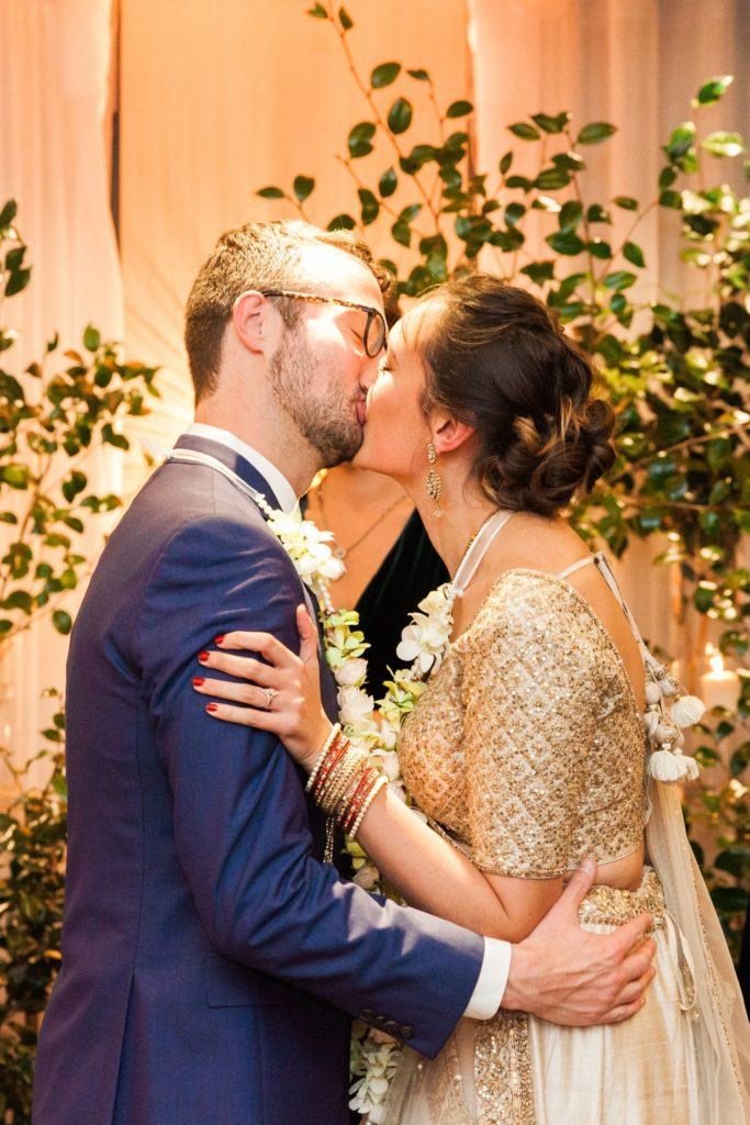 Bride and grooms first kiss after their South Place Hotel wedding