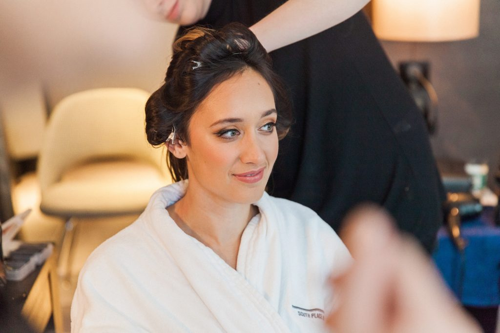 Indian bride getting her hair and make up done on the morning of her South Place Hotel wedding in London