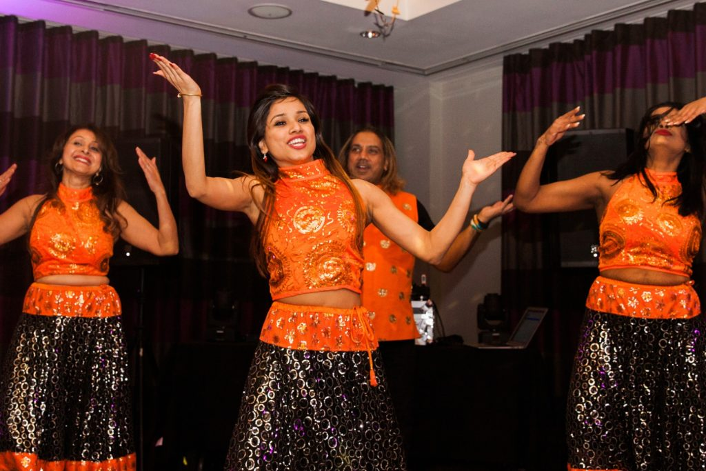 Performers from Dance With Jay Kumar entertaining guests at a South Place Hotel wedding