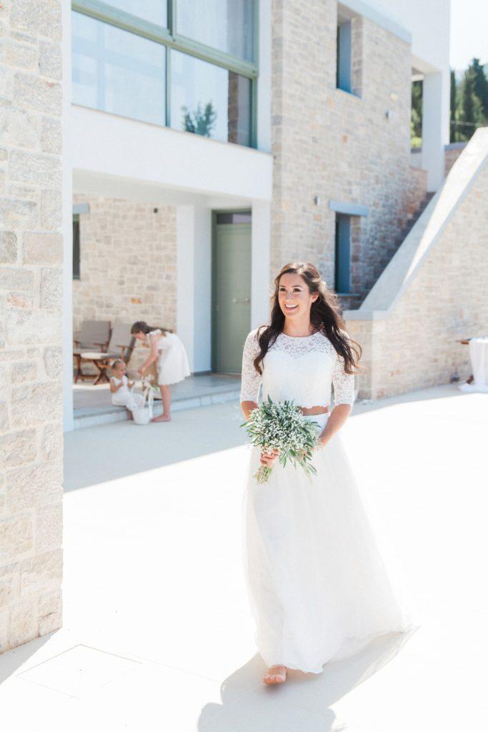 Bride arriving at her villa elopement ceremony on Lefkada