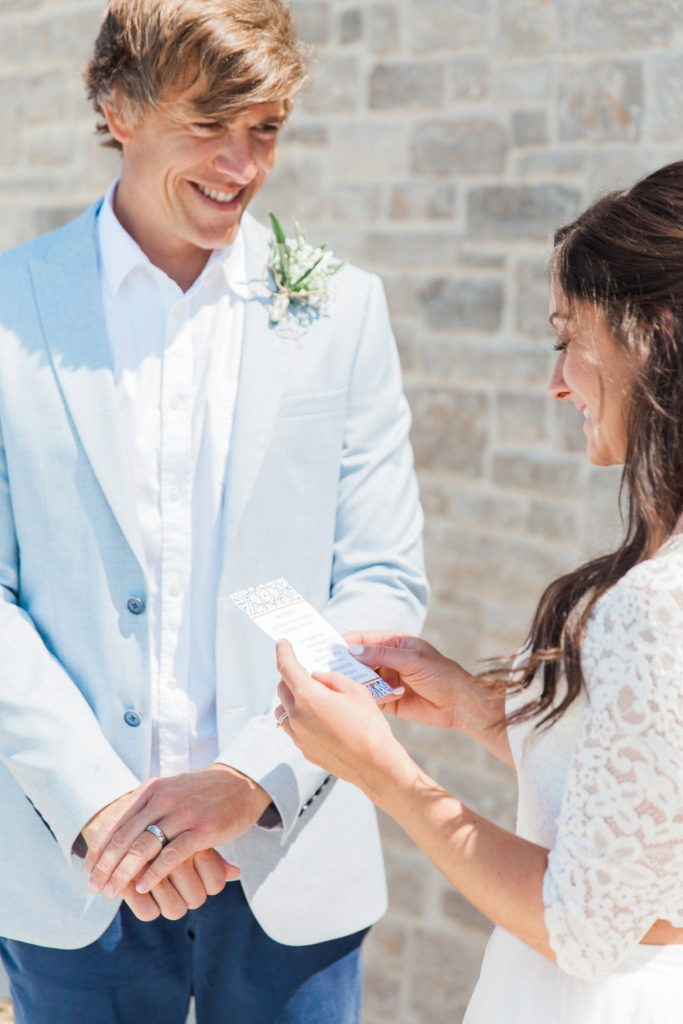 Bride and groom exchanging vows during their villa elopement