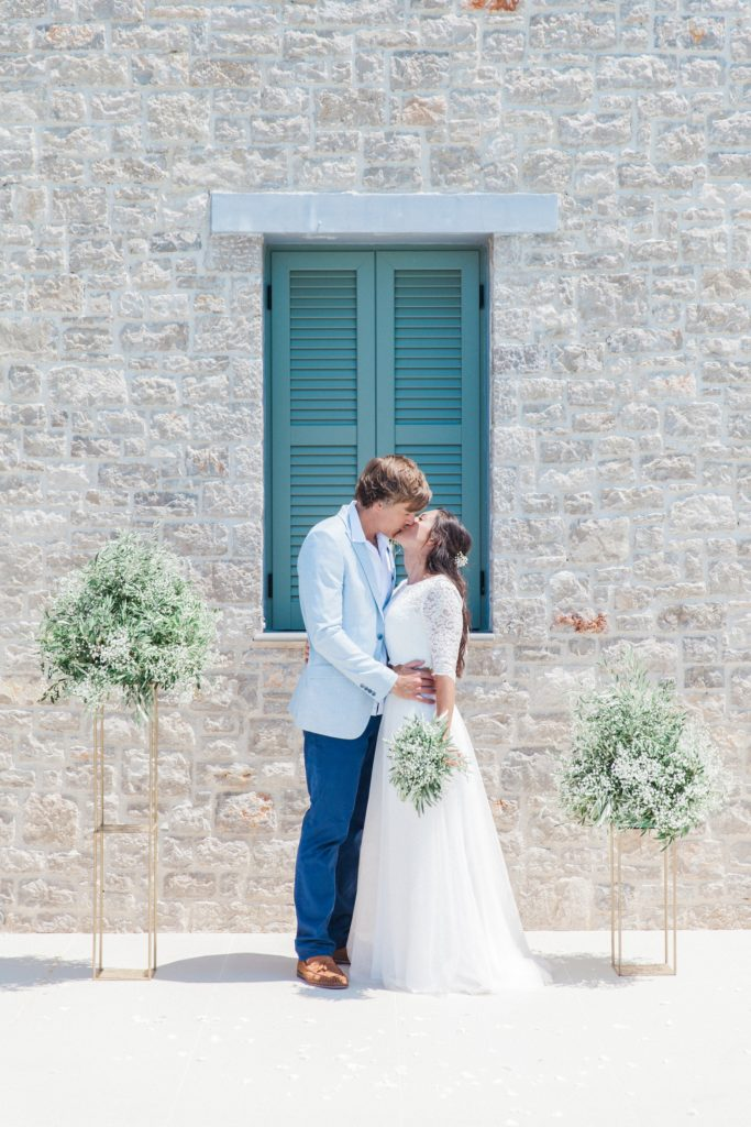 Couples first kiss after their villa elopement in Greece