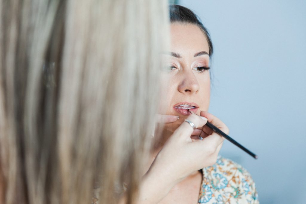 Bride getting her make up applied by make-up artist Despoina Kourbei