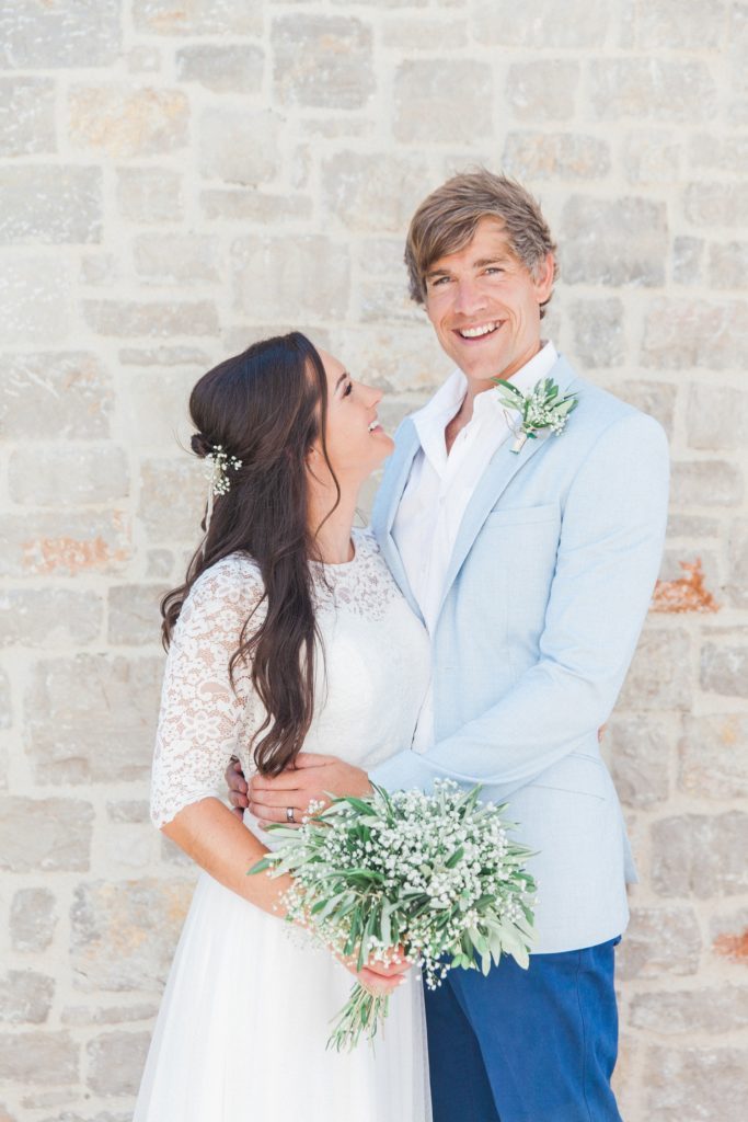 Couple smile after their villa elopement ceremony in Greece