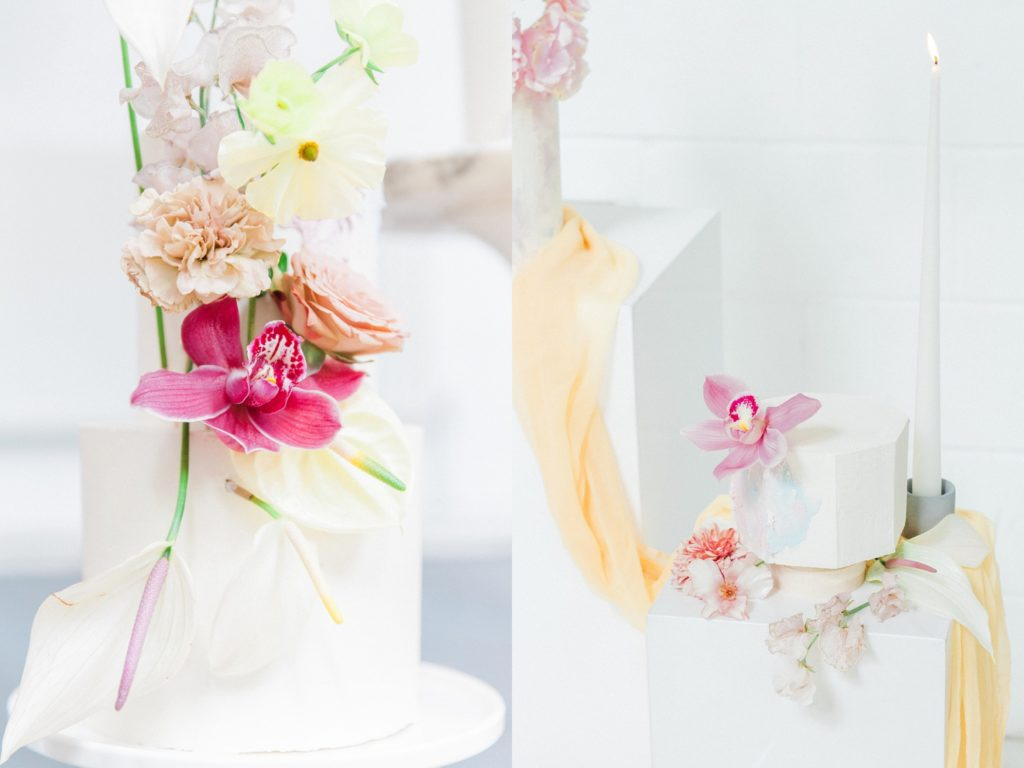 Colourful flower toppers on multi-sized white cakes by Avant Garde Cake Studio