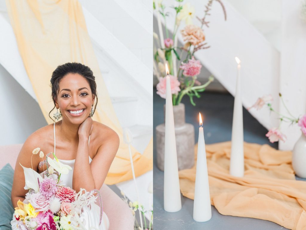 Portrait of a black bride in a Halfpenny London wedding gown sitting in a pink lounge chair with tapered candles