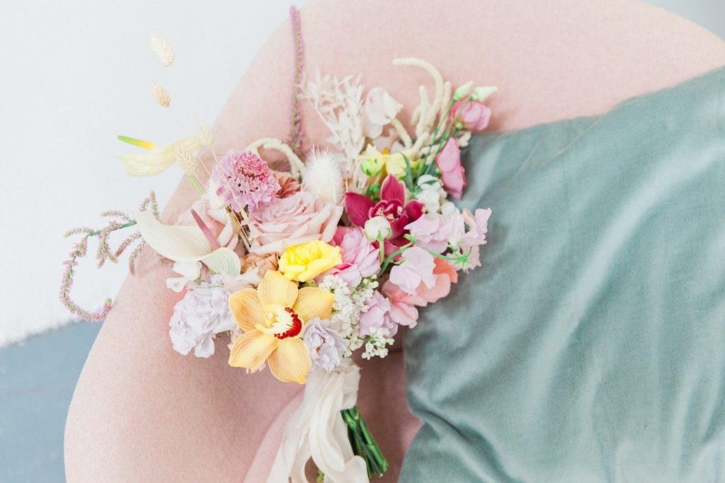 Colourful spring wedding bouquet featuring dried flowers, anthuriums and orchids