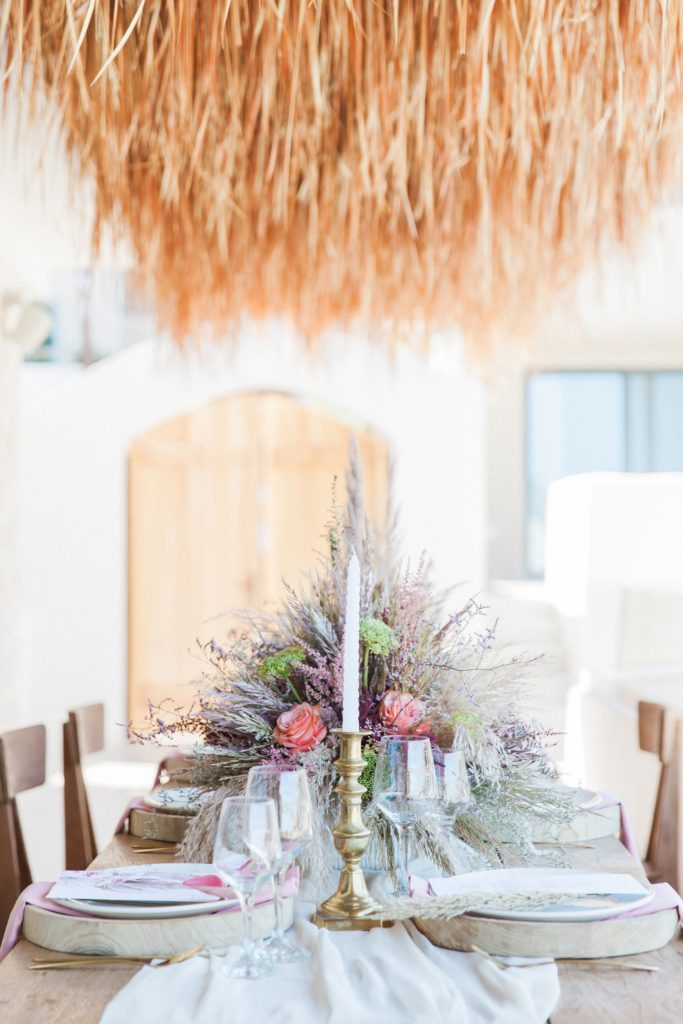 Boho table setting with dried grass hanging decorations at Crystal Waters Lefkada