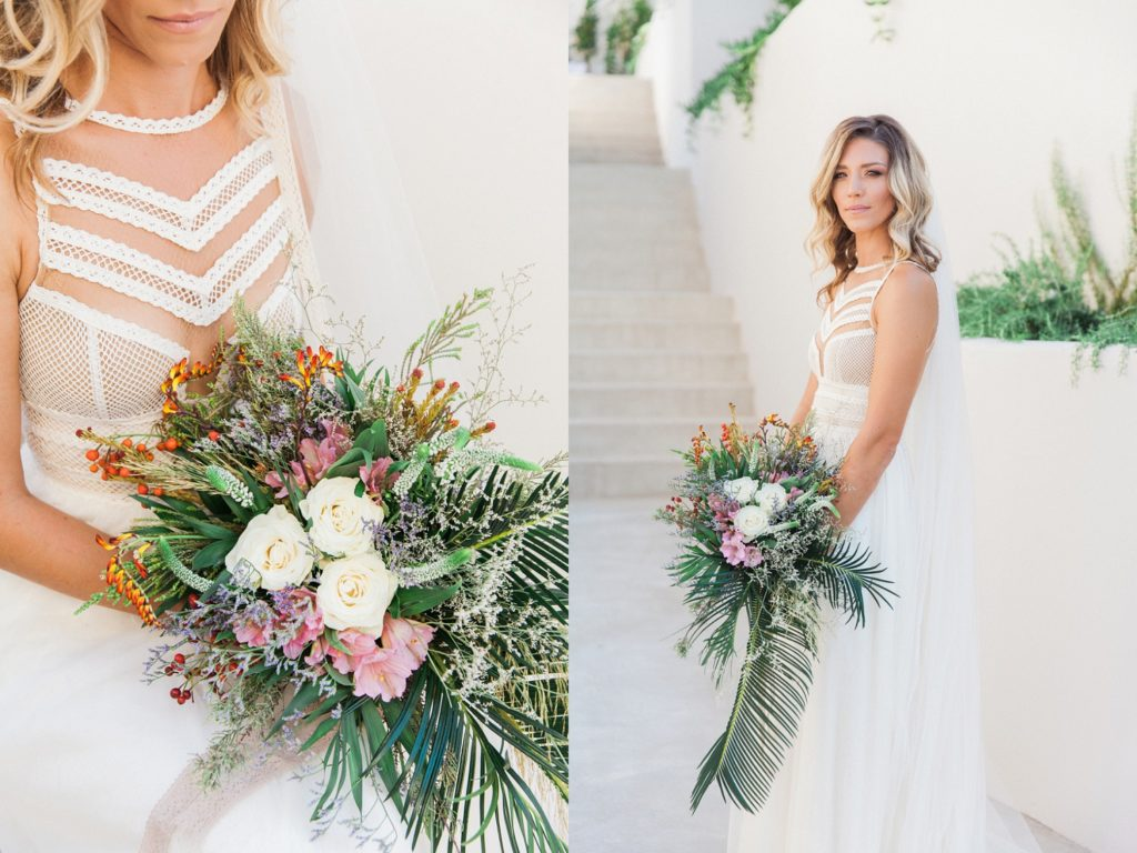 Bride in an ivory Atelier Zolotas gown with a boho bridal bouquet