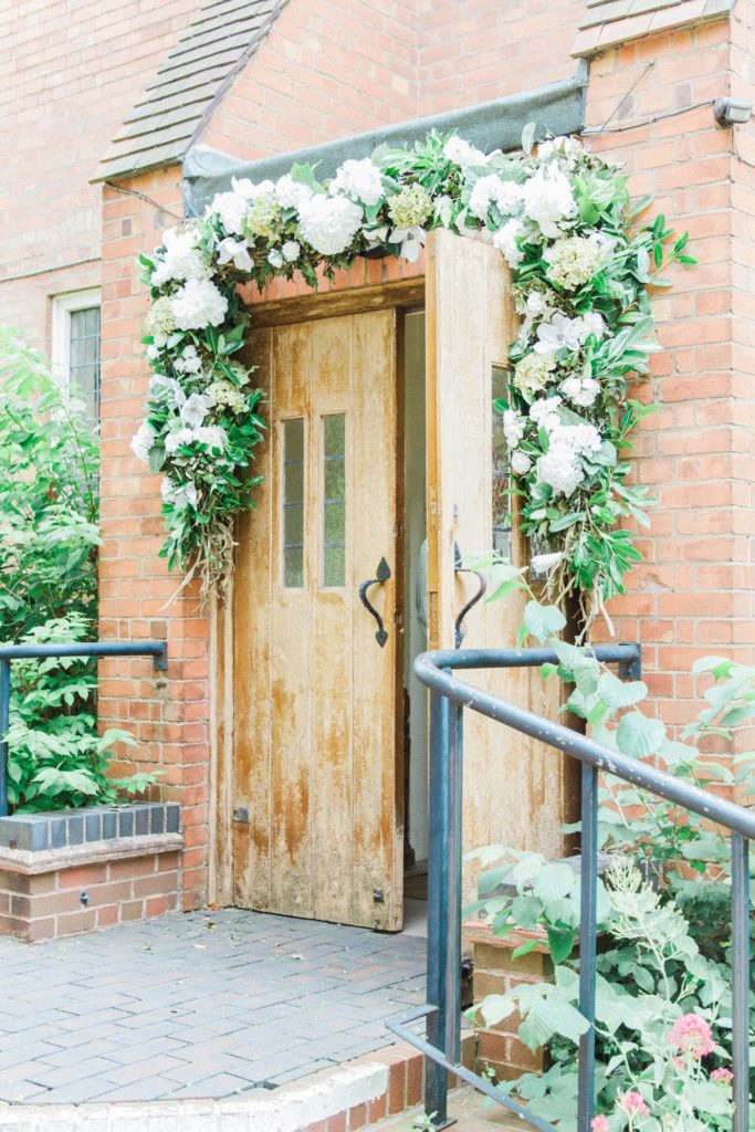 Ivy and hydrangea garland above the door of an English church