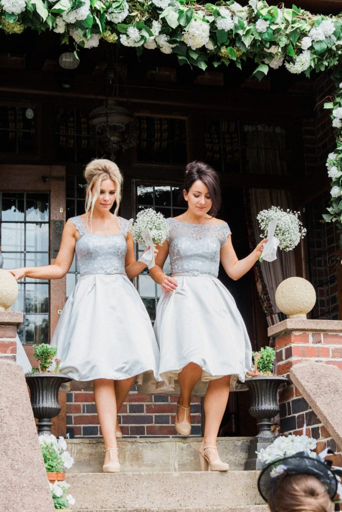 Bridesmaids arrive at a wedding reception in the garden of a private residence