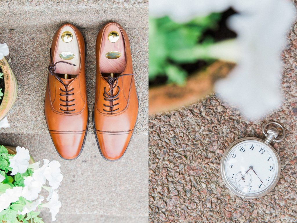 Detail image of the grooms leather shoes and pocket watch