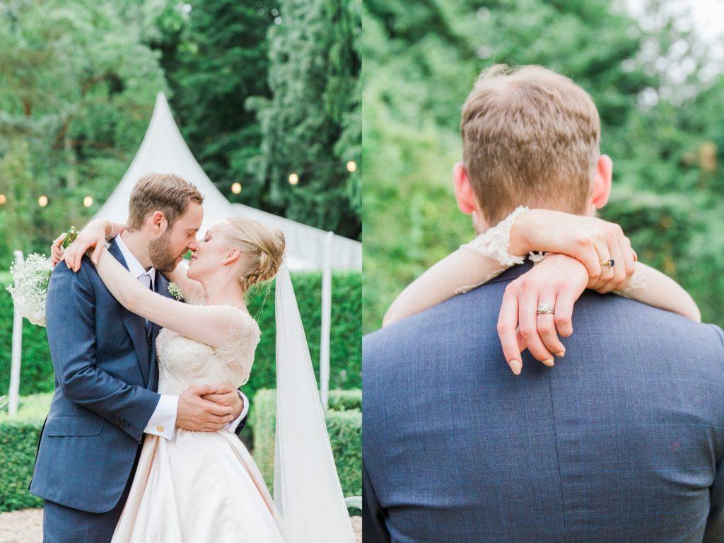 Bride and groom hug during their english garden wedding