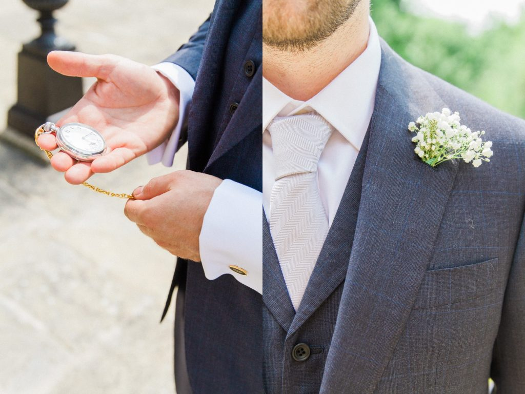 Groom inspects his pocket watch and Gypsophila buttonhole