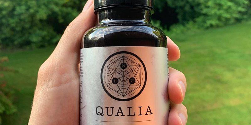 A bottle of Qualia Focus held in my hands