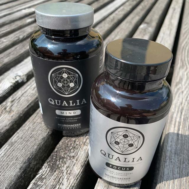 A bottle of Qualia Mind next to a bottle of Qualia Focus