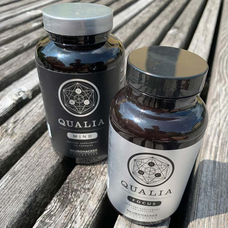A bottle of Qualia Mind next to a bottle of Qualia Focus