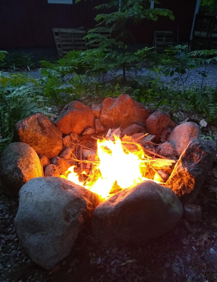 New fire pit with a raging fire in it.