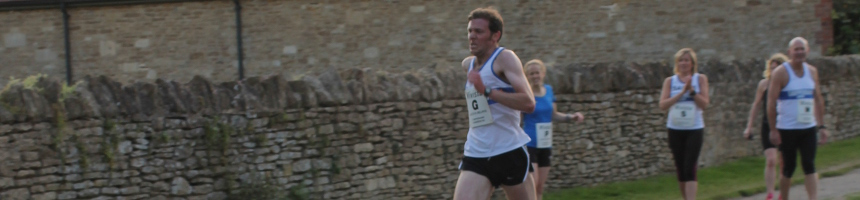 Runner sprinting to the lane in Lacock Relays