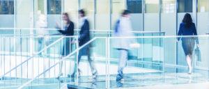 Business people walking in a modern office lobby