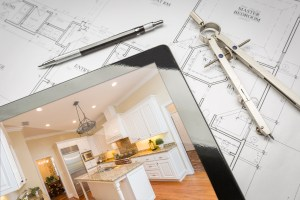 Computer Tablet Showing Finished Kitchen Sitting On House Plans With Pencil and Compass.http://www.feverpitchpro.com/istockphoto/stock-photo-moving-relocating-lightbox.jpg