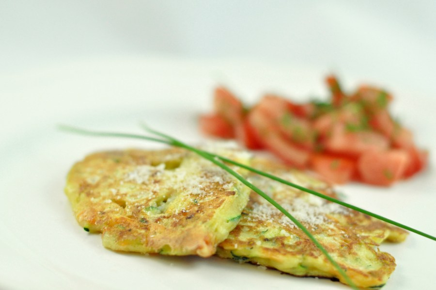 Zucchini and carrot fritters with chorrizo and Parmesan