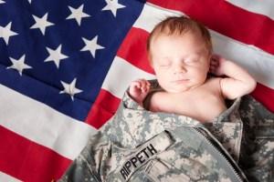 newborn in army jacket