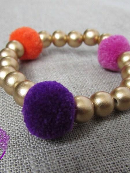bracelet_petite fille_may_bohème_perles_bois_doré_pompon_little manouche