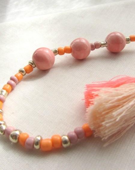 collier_little_manouche_perles_céramiques_pompons_orange_mandarine_may_boheme