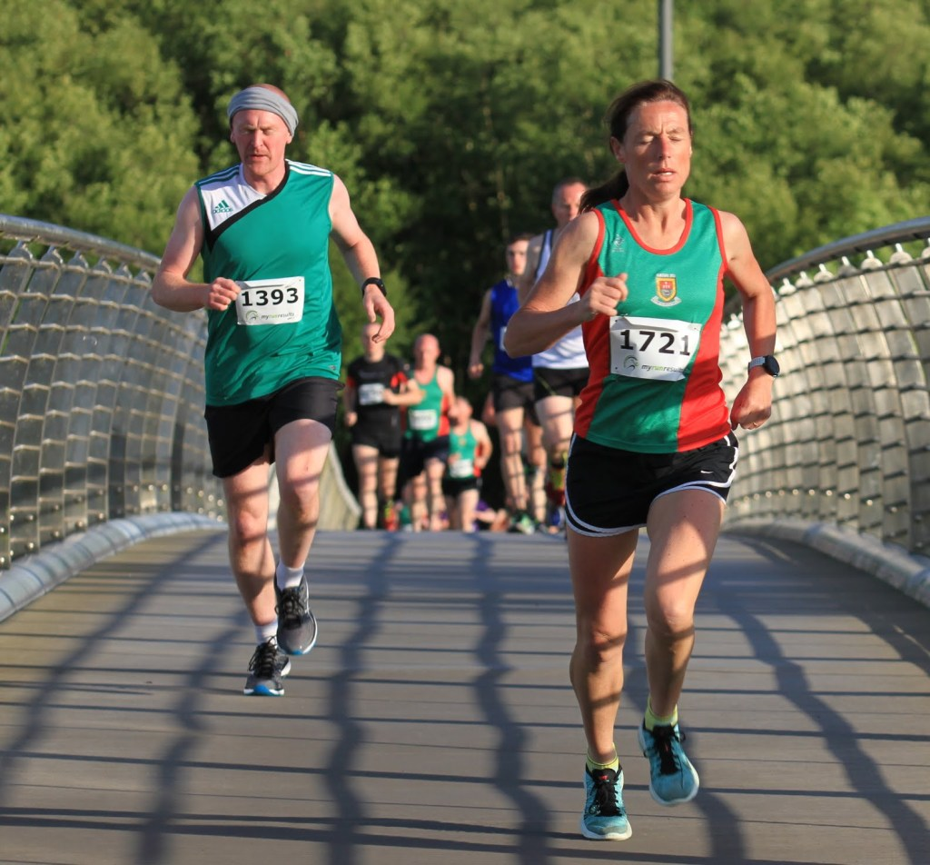 Mayo 5k Series 2017, women's race winner Colette Tuohy (Mayo AC) leads Evin McHale over Lough Lannagh bridge on the first lap of Castlebar 5k