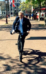 getting onto an electric bike in Amsterdam