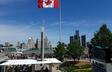 The Great Canadian Flag raising in front of the Detroit River.