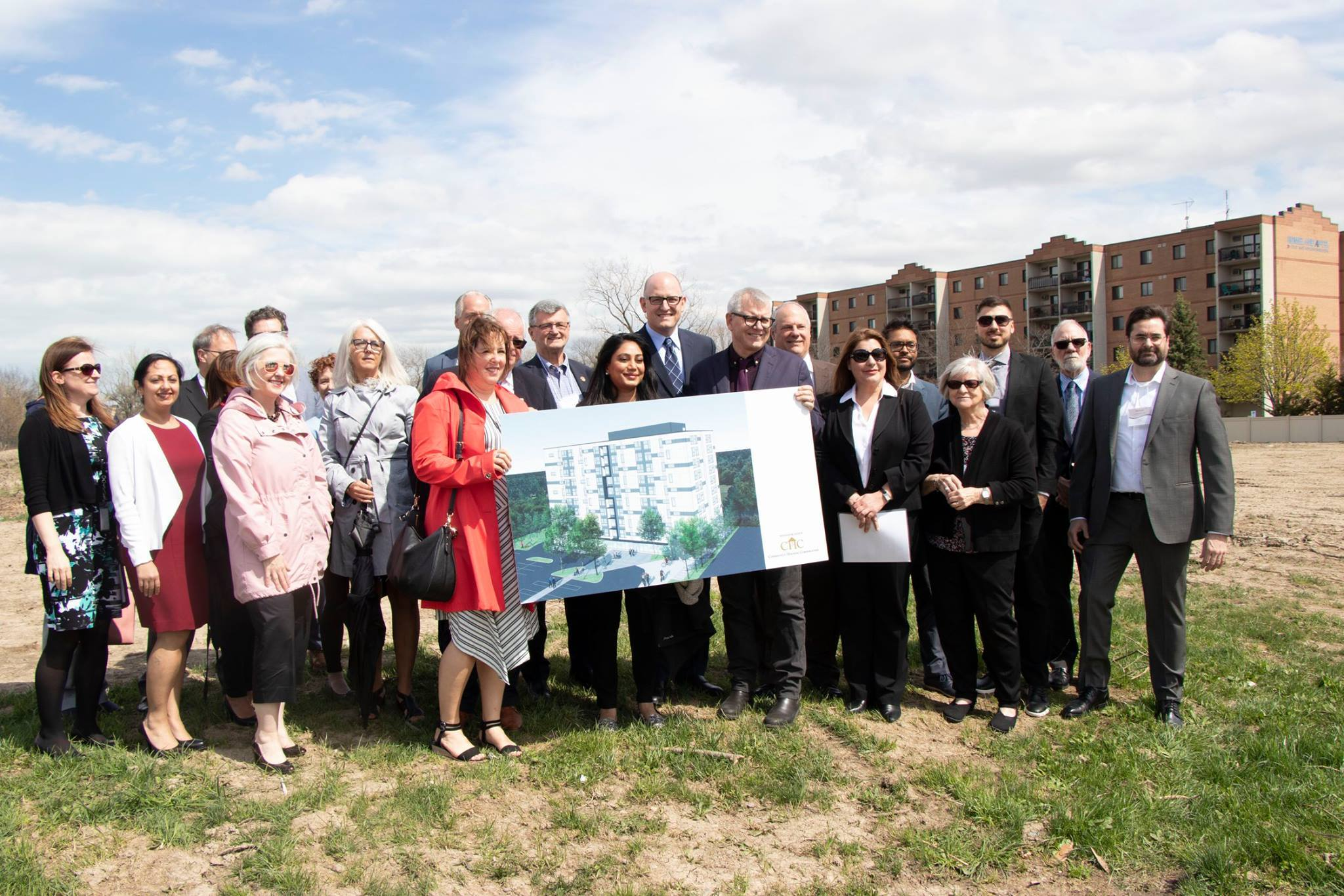 Group photo with building plans