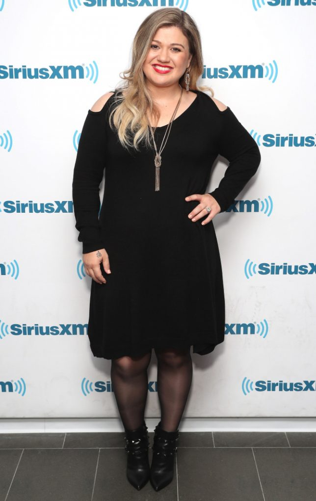 """NEW YORK, NY - OCTOBER 05: Kelly Clarkson is the first guest on Jenny McCarthy's new series, """"Inner Circle,"""" on her SiriusXM show """"The Jenny McCarthy Show"""" on October 5, 2016 in New York City. (Photo by Cindy Ord/Getty Images for SiriusXM)"""