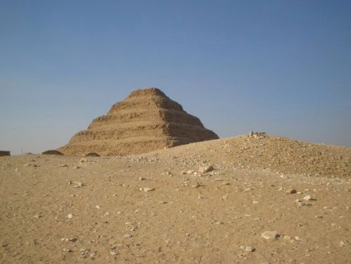 Pyramid of Djozer, Saqqara, half hidden by Egyptian sand dunes