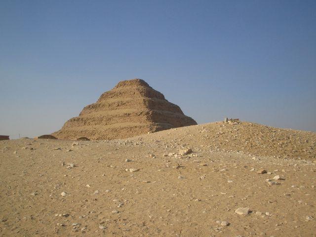 Pyramid of Djozer, Saqqara, half hidden by Egyptian sand dunes