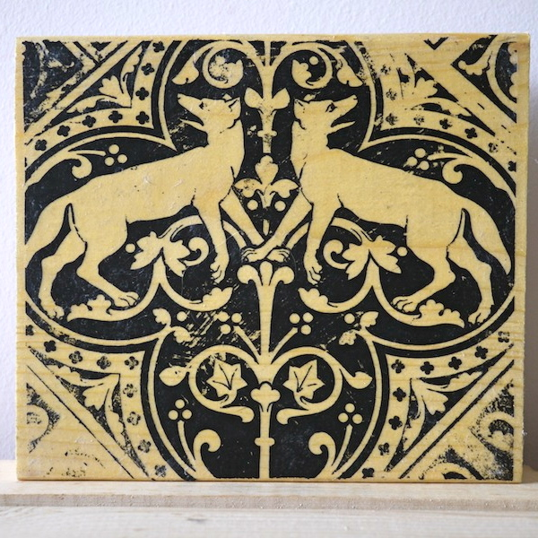 hunting wolves, wolf imagery, sainte chapelle, paris france, medieval tiles, religious iconography, circles and geometric designs, inlaid inlay floor tiles