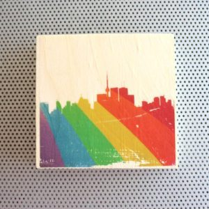 SIlhouette of Toronto with rainbow Pride spray art