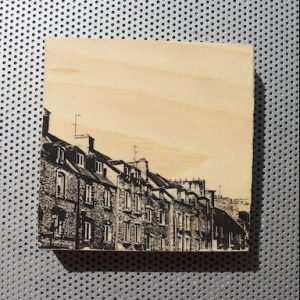 Old stone rowhouses in Cherbourg, France, printed on wood